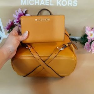 Michael Kors Bags - Michael kors backpack w/wallet set